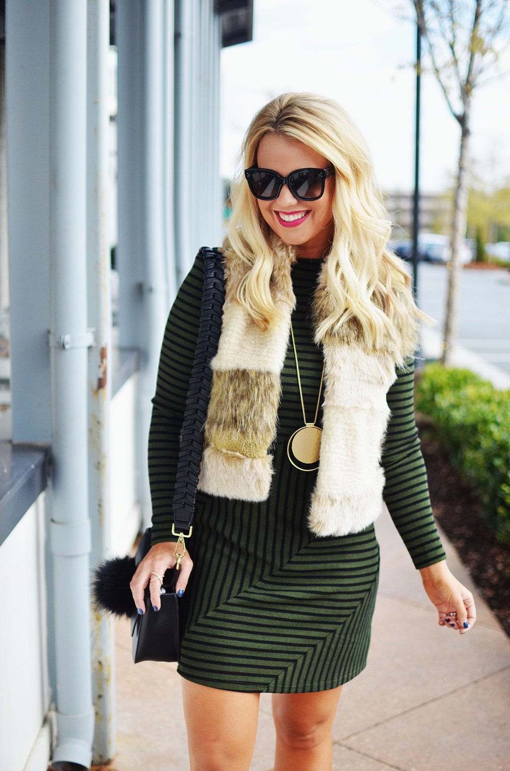 This entire outfit is 30% off! I absolutely love  this dress ,  this vest  is the perfect layering piece, I literally wear  this necklace  every other day and  this bag  makes the cutest holiday present!
