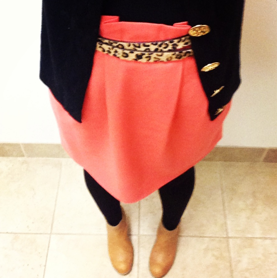 Courtney added a pop of color to a black and tan ensemble with a bright-coral skirt.